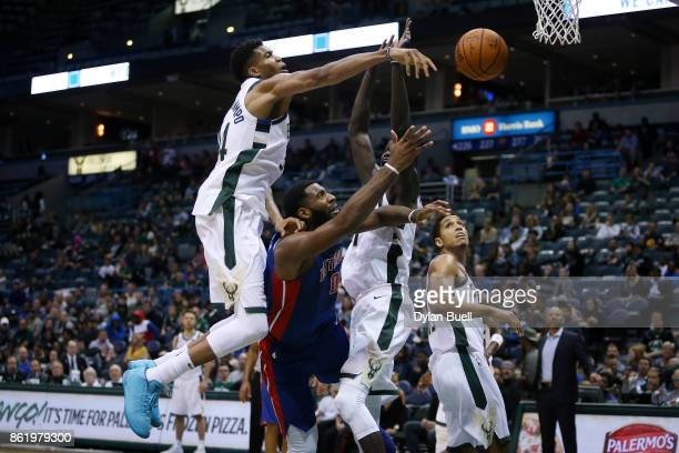 Giannis Antetokounmpo of the Milwaukee Bucks blocks a shot attempt by Andre Drummond of the Detroit Pistons in the third quarter during a preseason...
