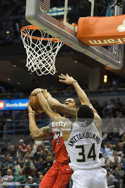 Giannis Antetokounmpo of the Milwaukee Bucks blocks a shot by Bradley Beal of the Washington Wizards during the second half of a game at the Bradley...