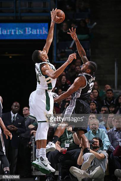 Giannis Antetokounmpo of the Milwaukee Bucks blocks Kawhi Leonard of the San Antonio Spurs on December 5 2016 at the BMO Harris Bradley Center in...