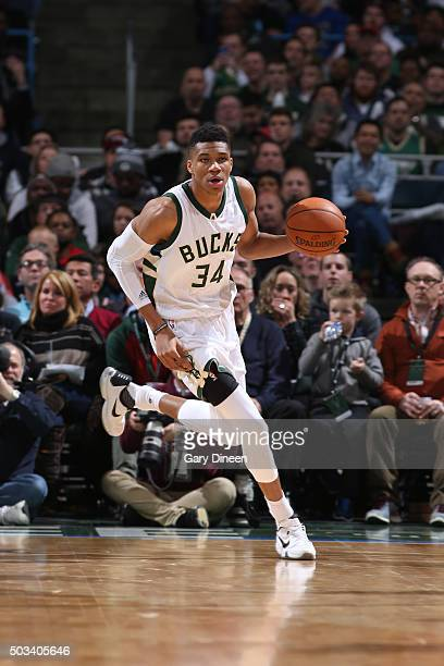Giannis Antetokounmpo of the Milwaukee Bucks brings the ball up court against the San Antonio Spurs on January 4 2016 at the BMO Harris Bradley...
