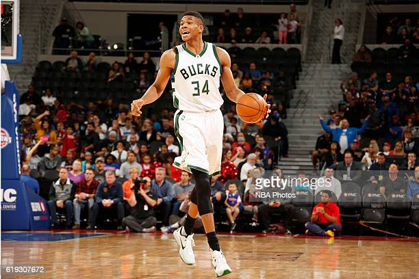Giannis Antetokounmpo of the Milwaukee Bucks brings the ball up court against the Detroit Pistons on October 30 2016 at The Palace of Auburn Hills in...