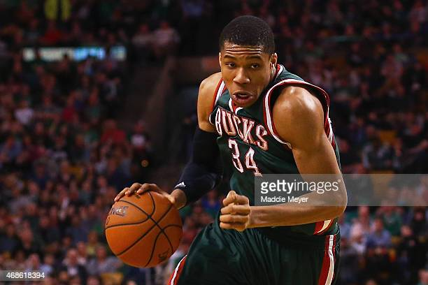 Giannis Antetokounmpo of the Milwaukee Bucks carries the ball against the Boston Celtics during the fourth quarter at TD Garden on April 3 2015 in...