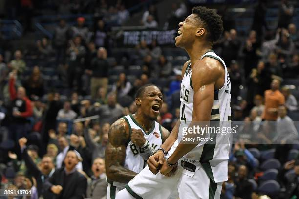 Giannis Antetokounmpo of the Milwaukee Bucks celebrates a dunk with Eric Bledsoe during the second half of a game against the Utah Jazz at the...