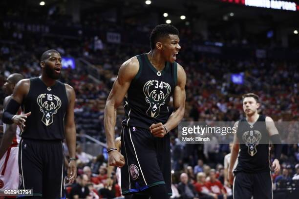 Giannis Antetokounmpo of the Milwaukee Bucks celebrates against the Toronto Raptors on April 15 2017 during Game One of Round One of the 2017 NBA...