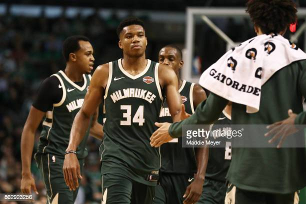 Giannis Antetokounmpo of the Milwaukee Bucks celebrates with teammates during the fourth quarter against the Boston Celtics at TD Garden on October...