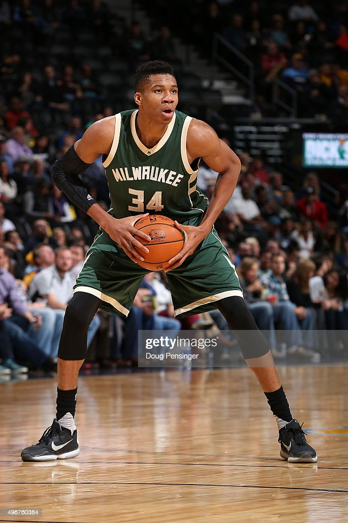 Giannis Antetokounmpo of the Milwaukee Bucks controls the ball against the Denver Nuggets at Pepsi Center on November 11 2015 in Denver Colorado The...