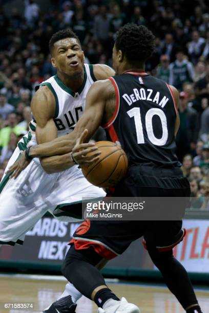 Giannis Antetokounmpo of the Milwaukee Bucks draws contact from DeMar DeRozan of the Toronto Raptors during the first half of Game Four of the...