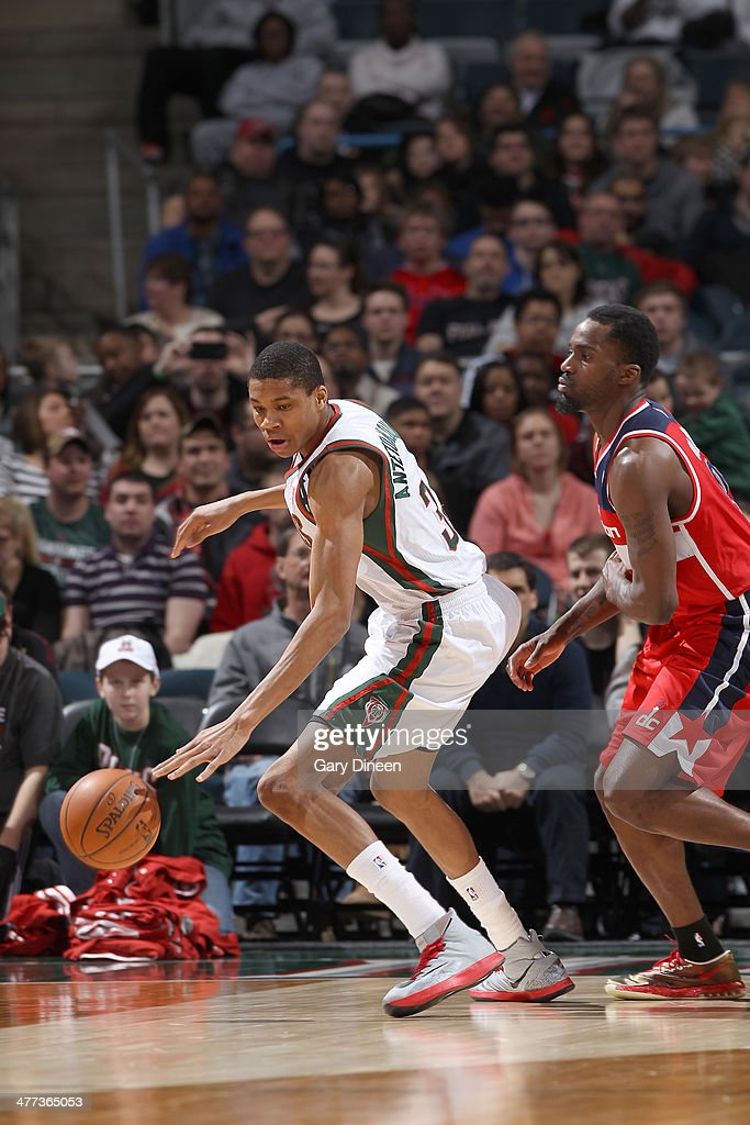 Giannis Antetokounmpo #34 of the Milwaukee Bucks dribbles against Martell Webster #9 of the Washington Wizards on March 8, 2014 at the BMO Harris Bradley Center in Milwaukee, Wisconsin.