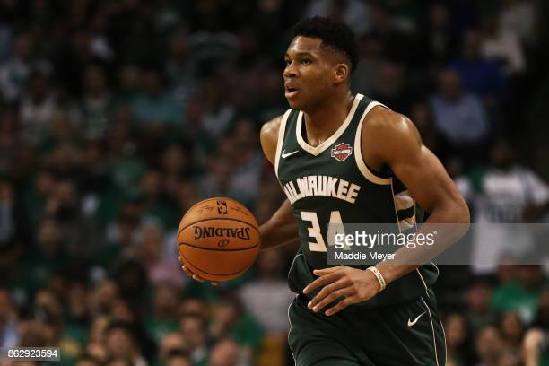 Giannis Antetokounmpo of the Milwaukee Bucks dribbles against the Boston Celtics during the second quarter at TD Garden on October 18 2017 in Boston...