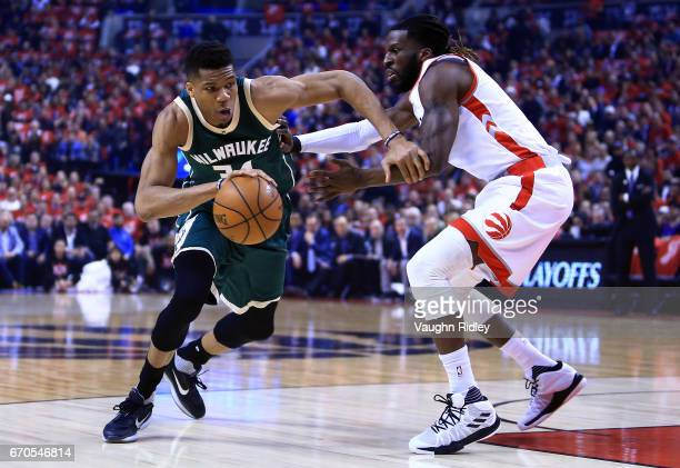 Giannis Antetokounmpo of the Milwaukee Bucks dribbles the ball as DeMarre Carroll of the Toronto Raptors defends in the first half of Game Two of the...