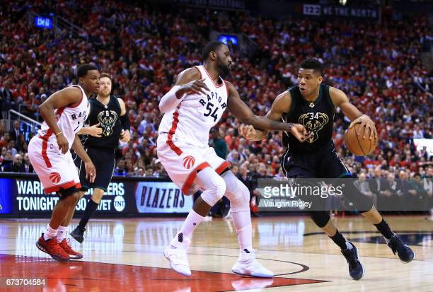 Giannis Antetokounmpo of the Milwaukee Bucks dribbles the ball as Patrick Patterson of the Toronto Raptors defends in the second half of Game Five of...