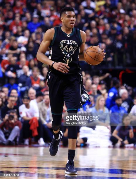 Giannis Antetokounmpo of the Milwaukee Bucks dribbles the ball in the first half of Game One of the Eastern Conference Quarterfinals against the...