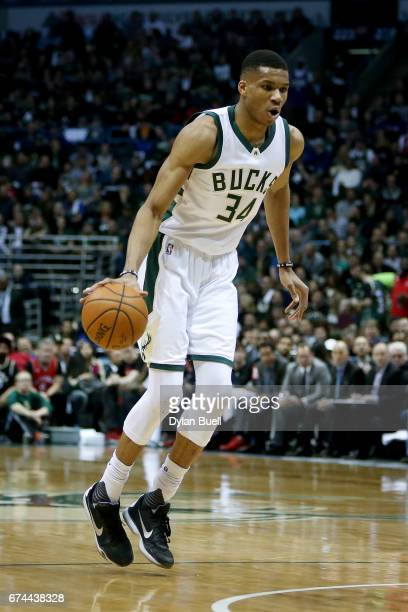 Giannis Antetokounmpo of the Milwaukee Bucks dribbles the ball in the first quarter in Game Six of the Eastern Conference Quarterfinals against the...