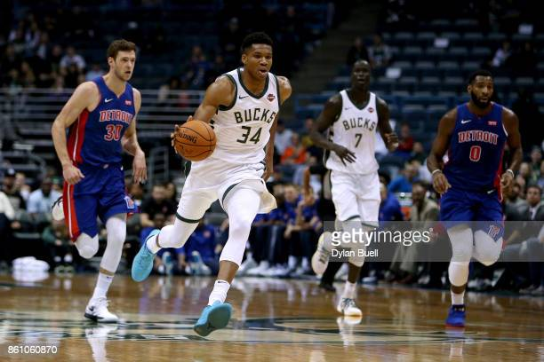 Giannis Antetokounmpo of the Milwaukee Bucks dribbles the ball in the first quarter during a preseason game against the Detroit Pistons at BMO Harris...
