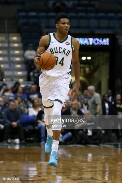 Giannis Antetokounmpo of the Milwaukee Bucks dribbles the ball in the second quarter against the Detroit Pistons during a preseason game at BMO...