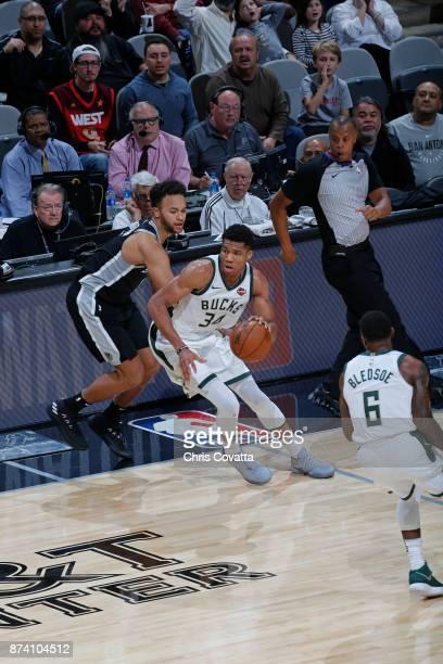 Giannis Antetokounmpo of the Milwaukee Bucks dribbles the ball up court against the Milwaukee Bucks on November 10 2017 at the ATT Center in San...
