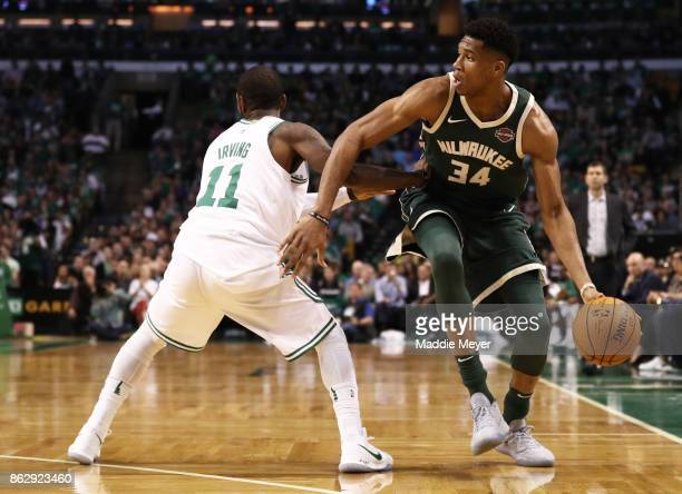 Giannis Antetokounmpo of the Milwaukee Bucks drives against Kyrie Irving of the Boston Celtics during the second quarter at TD Garden on October 18...
