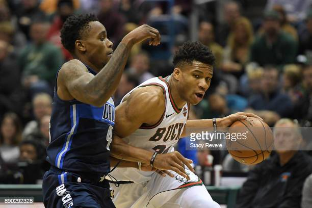 Giannis Antetokounmpo of the Milwaukee Bucks drives around Harrison Barnes of the Dallas Mavericks during a game at the Bradley Center on December 8...