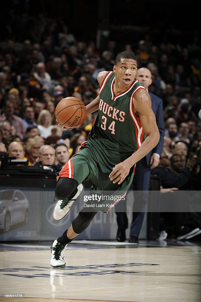 Giannis Antetokounmpo of the Milwaukee Bucks drives to the basket against the Cleveland Cavaliers on December 31 2014 at The Quicken Loans Arena in...