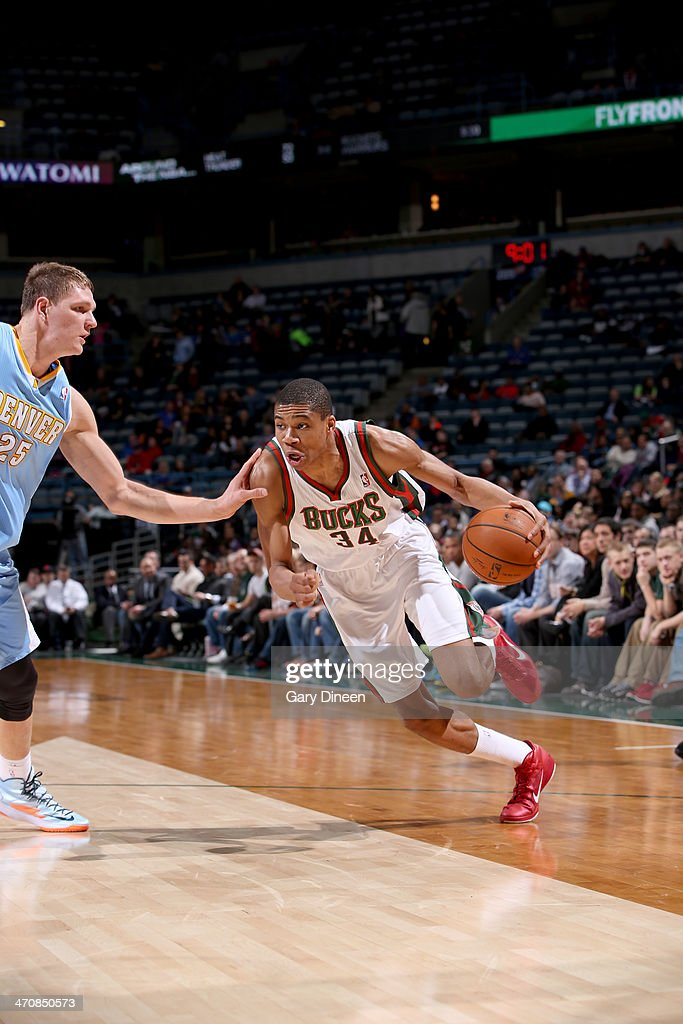 <a gi-track='captionPersonalityLinkClicked' href=/galleries/search?phrase=Giannis+Antetokounmpo&family=editorial&specificpeople=11078379 ng-click='$event.stopPropagation()'>Giannis Antetokounmpo</a> #34 of the Milwaukee Bucks drives to the basket against Timofey Mozgov #25 of the Denver Nuggets on February 20, 2014 at the BMO Harris Bradley Center in Milwaukee, Wisconsin.