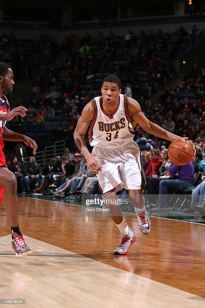 <a gi-track='captionPersonalityLinkClicked' href=/galleries/search?phrase=Giannis+Antetokounmpo&family=editorial&specificpeople=11078379 ng-click='$event.stopPropagation()'>Giannis Antetokounmpo</a> #34 of the Milwaukee Bucks drives to the basket against the Washington Wizards on March 8, 2014 at the BMO Harris Bradley Center in Milwaukee, Wisconsin.