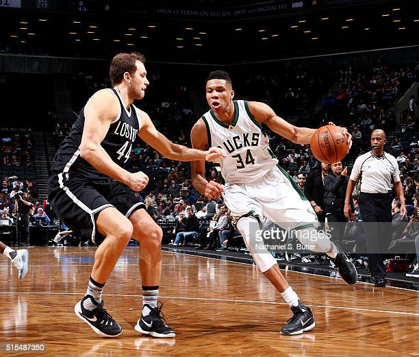 Giannis Antetokounmpo of the Milwaukee Bucks drives to the basket against Bojan Bogdanovic of the Brooklyn Nets on March 13 2016 at Barclays Center...