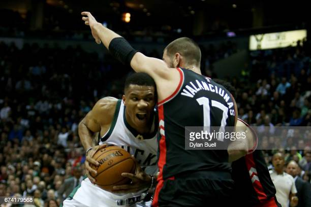 Giannis Antetokounmpo of the Milwaukee Bucks drives to the basket while being guarded by Jonas Valanciunas of the Toronto Raptors in the second...