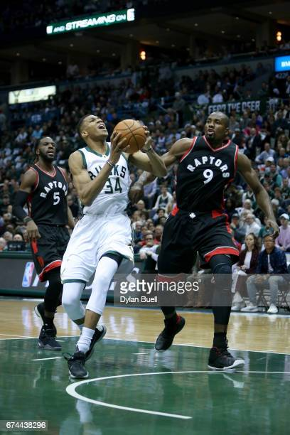 Giannis Antetokounmpo of the Milwaukee Bucks drives to the basket while being guarded by Serge Ibaka of the Toronto Raptors in the first quarter in...
