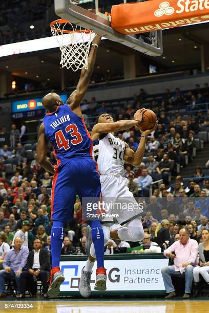 Giannis Antetokounmpo of the Milwaukee Bucks drives to the basket against Anthony Tolliver of the Detroit Pistons during the first half of a game at...