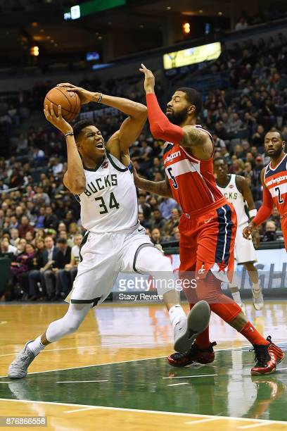 Giannis Antetokounmpo of the Milwaukee Bucks drives to the basket against Markieff Morris of the Washington Wizards during the first half of a game...