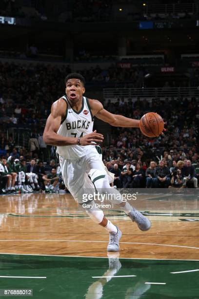 Giannis Antetokounmpo of the Milwaukee Bucks drives to the basket against the Washington Wizards on November 20 2017 at the BMO Harris Bradley Center...