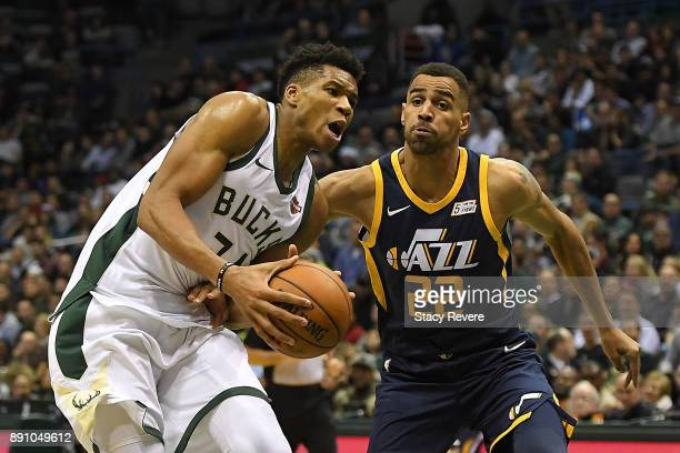 Giannis Antetokounmpo of the Milwaukee Bucks drives to the basket against Thabo Sefolosha of the Utah Jazz during a game at the Bradley Center on...