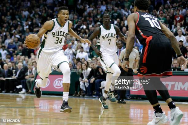 Giannis Antetokounmpo of the Milwaukee Bucks drives to the hoop against DeMar DeRozan of the Toronto Raptors during the first half of Game Four of...