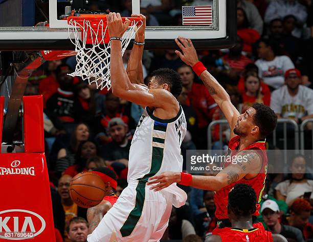Giannis Antetokounmpo of the Milwaukee Bucks dunks against Thabo Sefolosha of the Atlanta Hawks at Philips Arena on January 15 2017 in Atlanta...