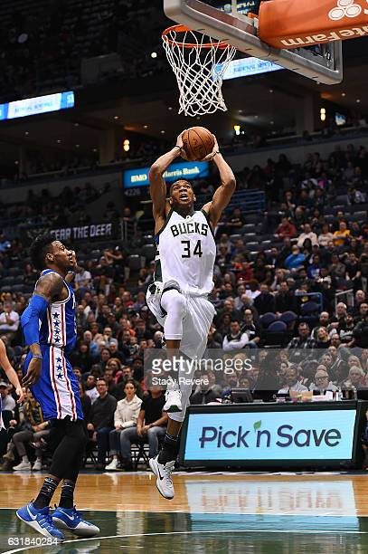Giannis Antetokounmpo of the Milwaukee Bucks dunks against the Philadelphia 76ers during the first half of a game at BMO Harris Bradley Center on...