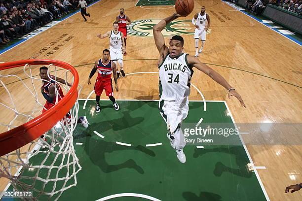 Giannis Antetokounmpo of the Milwaukee Bucks dunks against the Boston Celtics on December 23 2016 at the BMO Harris Bradley Center in Milwaukee...