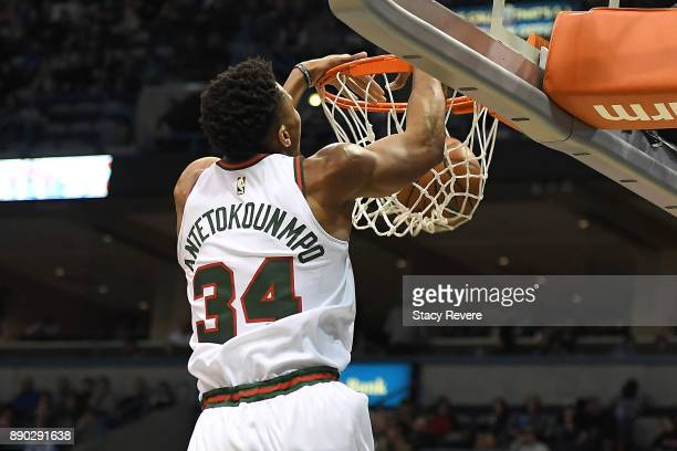 Giannis Antetokounmpo of the Milwaukee Bucks dunks against the Dallas Mavericks during the first half of a game at the Bradley Center on December 8...