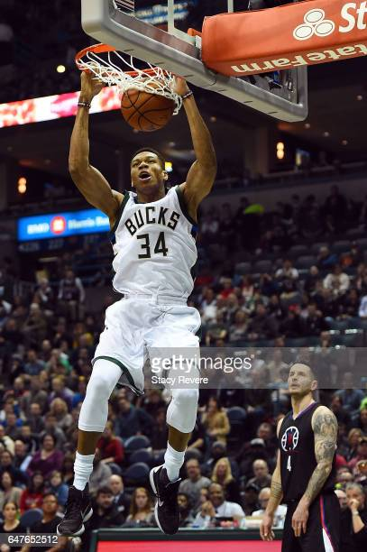 Giannis Antetokounmpo of the Milwaukee Bucks dunks against the Los Angeles Clippers during the first half of a game at the BMO Harris Bradley Center...