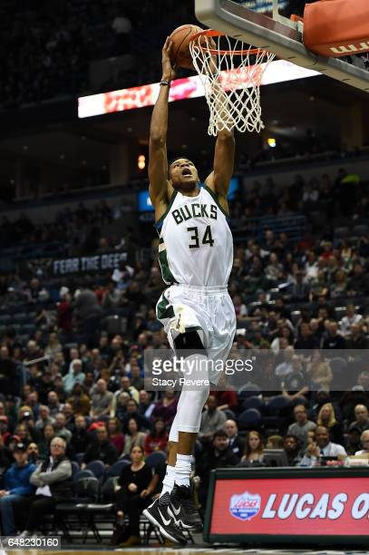 Giannis Antetokounmpo of the Milwaukee Bucks dunks against the Los Angeles Clippers at the BMO Harris Bradley Center on March 3 2017 in Milwaukee...