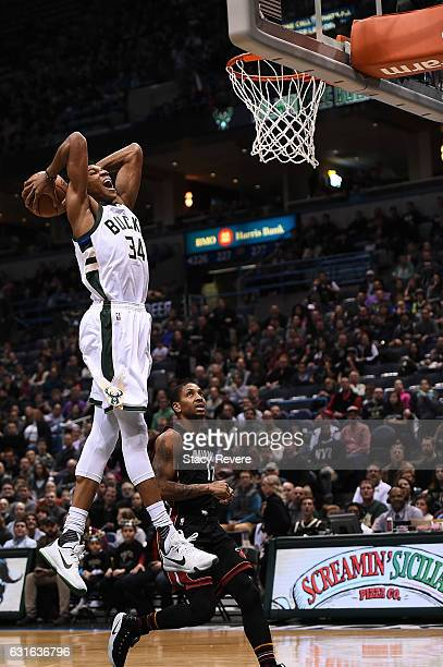 Giannis Antetokounmpo of the Milwaukee Bucks dunks against the Miami Heat during the first half of a game at BMO Harris Bradley Center on January 13...