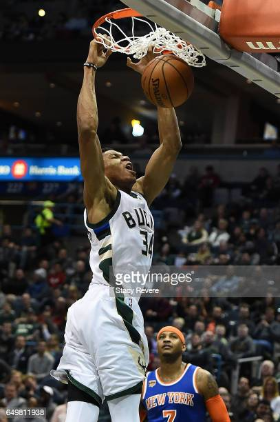Giannis Antetokounmpo of the Milwaukee Bucks dunks against the New York Knicks during the first half of a game at the BMO Harris Bradley Center on...