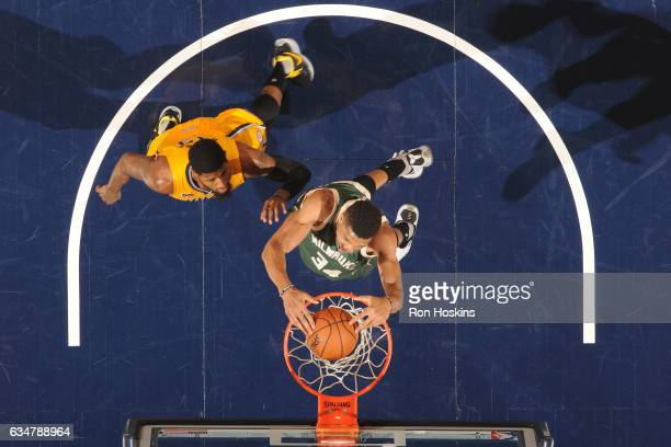 Giannis Antetokounmpo of the Milwaukee Bucks dunks against the Indiana Pacers on February 11 2017 at Bankers Life Fieldhouse in Indianapolis Indiana...