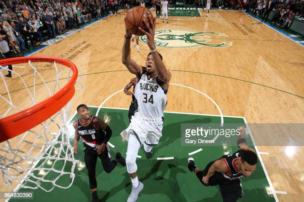 Giannis Antetokounmpo of the Milwaukee Bucks dunks and put his team in the lead against the Portland Trail Blazers on October 21 2017 at the BMO...