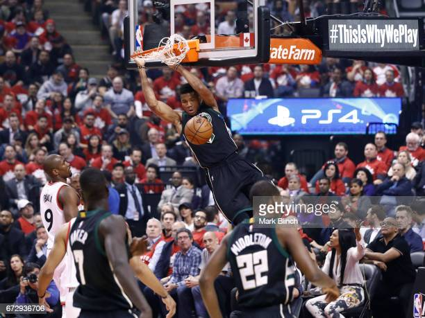 Giannis Antetokounmpo of the Milwaukee Bucks dunks the ball against the Toronto Raptors during Game Five of the Eastern Conference Quarterfinals of...
