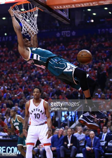 Giannis Antetokounmpo of the Milwaukee Bucks dunks the ball as DeMar DeRozan of the Toronto Raptors looks on in the first half of Game Two of the...