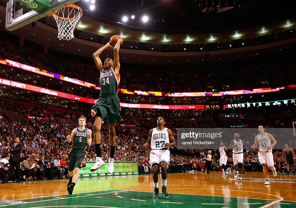 <a gi-track='captionPersonalityLinkClicked' href=/galleries/search?phrase=Giannis+Antetokounmpo&family=editorial&specificpeople=11078379 ng-click='$event.stopPropagation()'>Giannis Antetokounmpo</a> #34 of the Milwaukee Bucks dunks the ball in front of <a gi-track='captionPersonalityLinkClicked' href=/galleries/search?phrase=Jordan+Crawford&family=editorial&specificpeople=4779380 ng-click='$event.stopPropagation()'>Jordan Crawford</a> #27 of the Boston Celtics in the second half during the home opener at TD Garden on November 1, 2013 in Boston, Massachusetts.