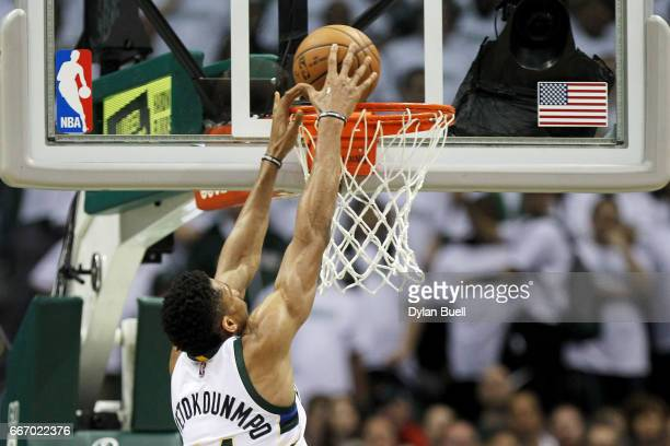 Giannis Antetokounmpo of the Milwaukee Bucks dunks the ball in the third quarter against the Charlotte Hornets at BMO Harris Bradley Center on April...
