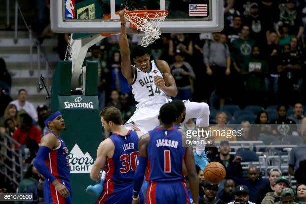 Giannis Antetokounmpo of the Milwaukee Bucks dunks the ball in the third quarter during a preseason game against the Detroit Pistons at BMO Harris...