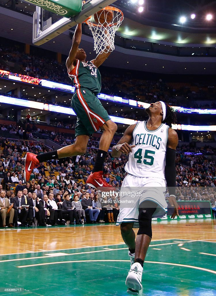 Giannis Antetokounmpo #34 of the Milwaukee Bucks dunks the ball over Gerald Wallace #45 of the Boston Celtics in the second half during the game at TD Garden on December 3, 2013 in Boston, Massachusetts.