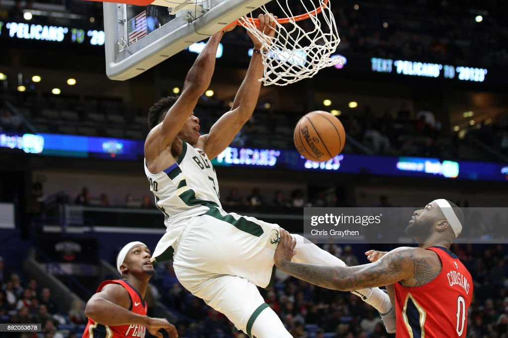 Giannis Antetokounmpo #34 of the Milwaukee Bucks dunks the ball over DeMarcus Cousins #0 of the New Orleans Pelicans at Smoothie King Center on December 13, 2017 in New Orleans, Louisiana.